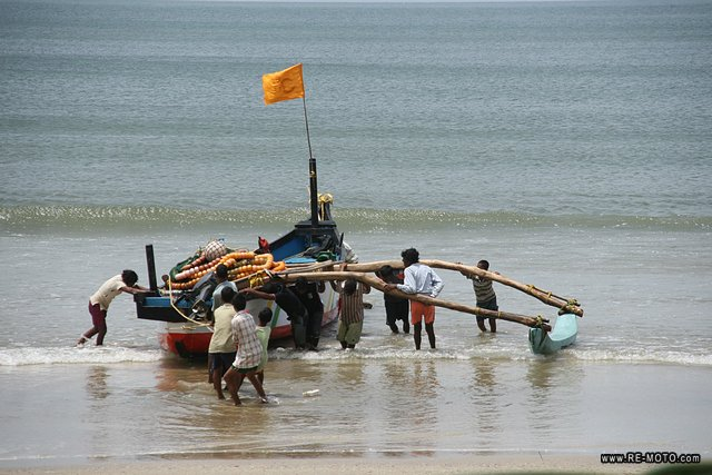 A fishing boat reaches the shore.