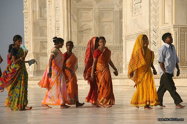 The coloured dresses stand out against the Taj.